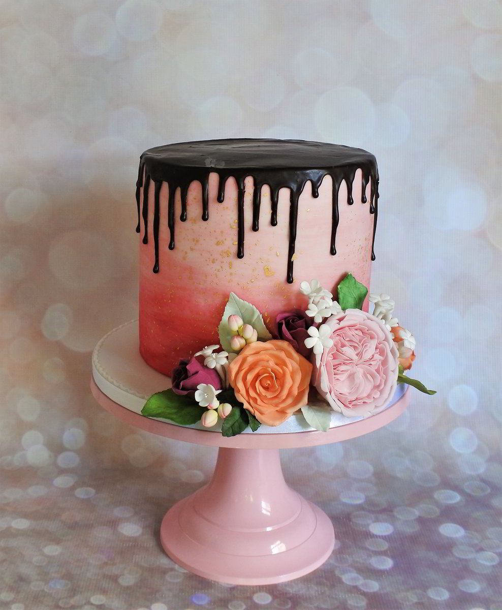 Pink Watercolour Effect with Gold Fleck and Dark Chocolate Ganache Drip, decorated with Sugar Flowers and Foliage