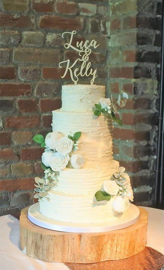 Rustic Butercream Wedding Cake decorated with handmade sugar flowers