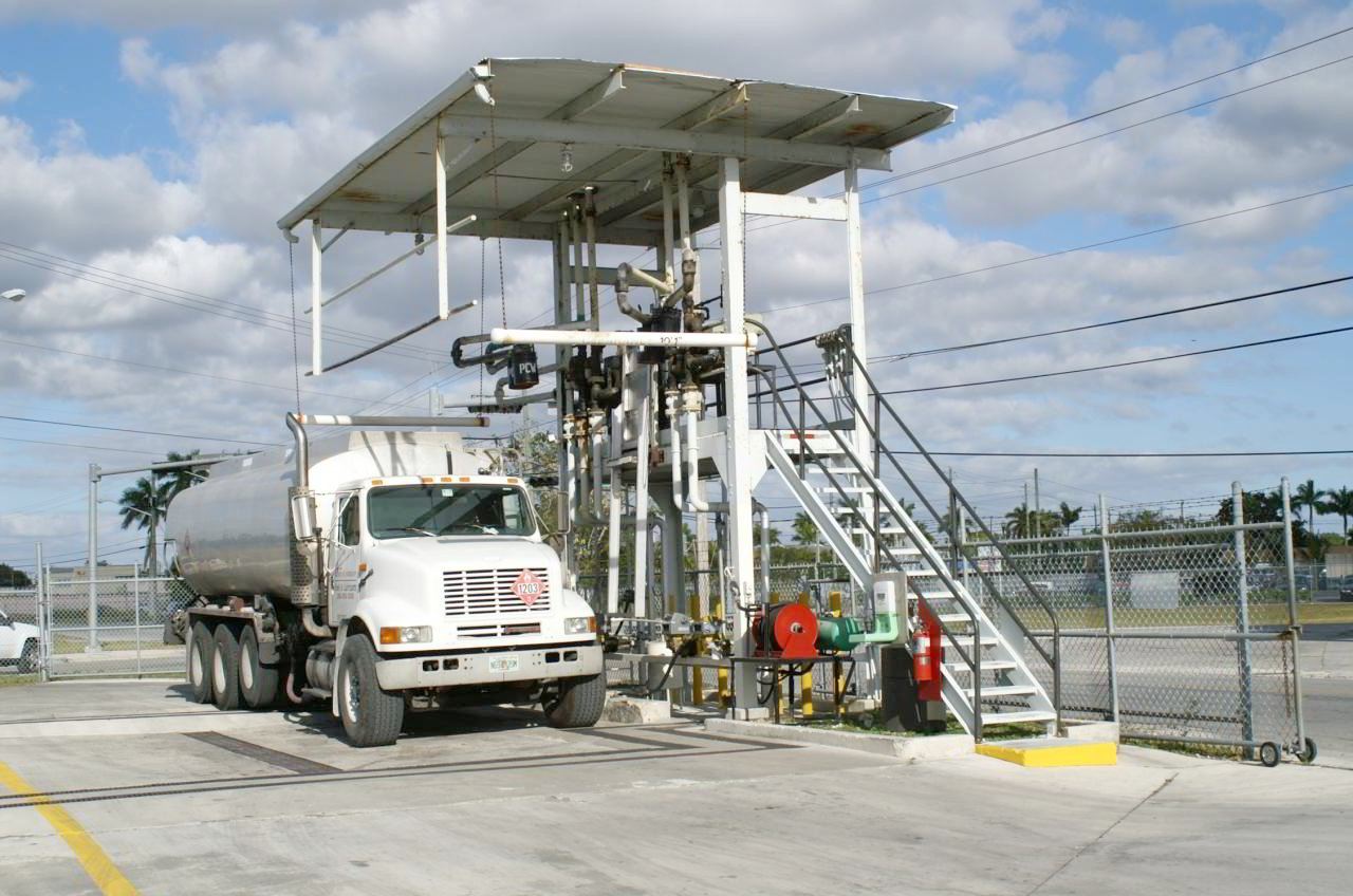 Fuel Products image of truck next to a station