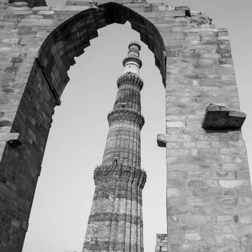 Delhi cityscapes limited edition black and white art photograph of Qutb Minar through an arch by Sanjay Marathe