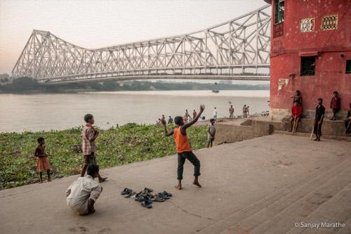 Title - 'Cricket At Howrah', Kolkata. Fine art photography print of Kolkata Cityscapes series by artist Sanjay Marathe