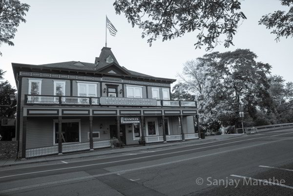 Fine art photography print of 'Pleasanton Hotel' in Classic Black & White by artist Sanjay Marathe.