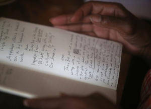 Michelle McAfee looks through her notebook during a memoir writing meeting on Sunday, Oct. 18, 2015, in Oakland, Calif. (Aric Crabb/Bay Area News Group)