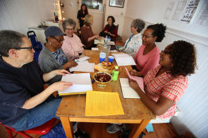 Michelle McAfee, right, leads a memoir-writing meeting on Sunday, Oct. 18, 2015, in Oakland, Calif. (Aric Crabb/Bay Area News Group)