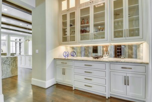 Cabinetry with detailed craftsmanship and open-face design