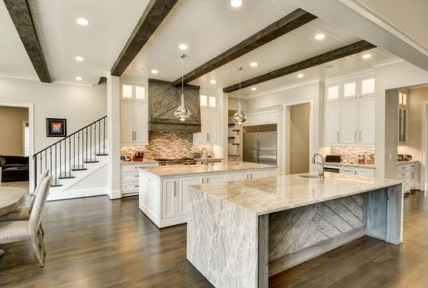Wood beamed ceiling in kitchen with double islands