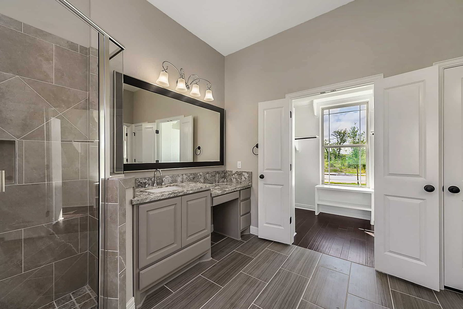 This is a Kaleo Homes master bathroom image for their new model home in Southern Pointe near College Station, TX.