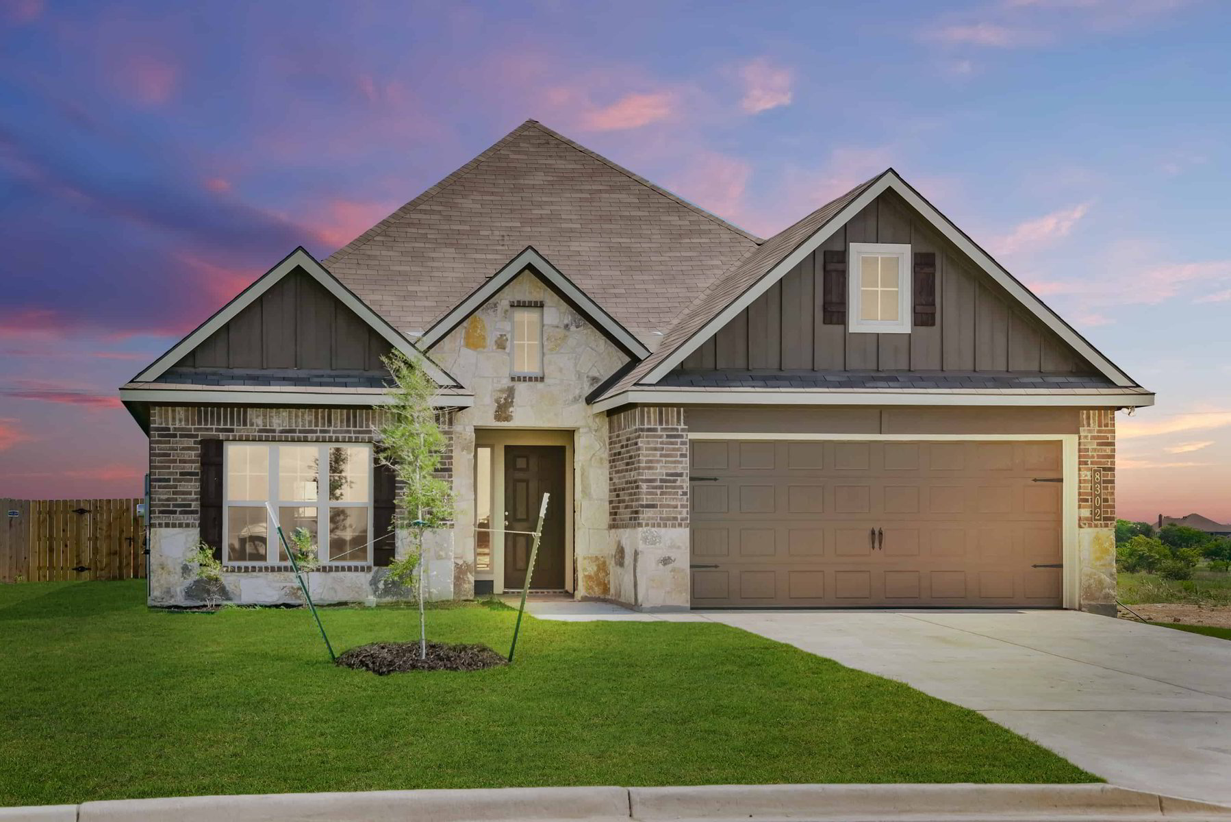 This is a Stylecraft Builders model home exterior image for their new homes in Southern Pointe near College Station, TX.