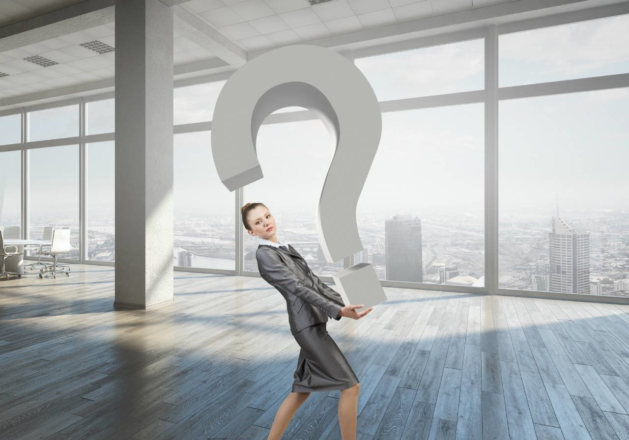 Woman carrying a large question mark